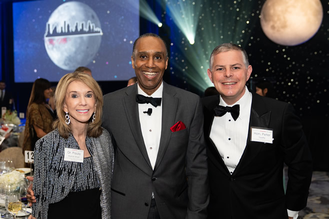 Provost Paula Myrick Short, Dean Leonard M. Baynes, and Peter Taaffe '97, vice-chairman of the UH System Board of Regents, enjoy the evening under the gala's moon and stars.